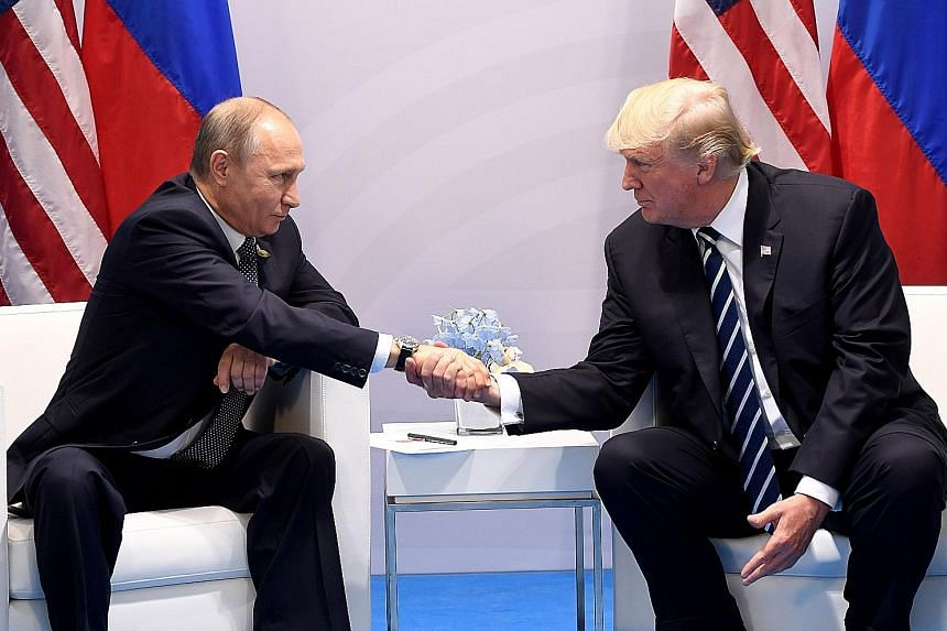 Mr Donald Trump (far right) with Mr Vladimir Putin during a meeting on the sidelines of the G-20 summit in Hamburg, Germany, last Friday.