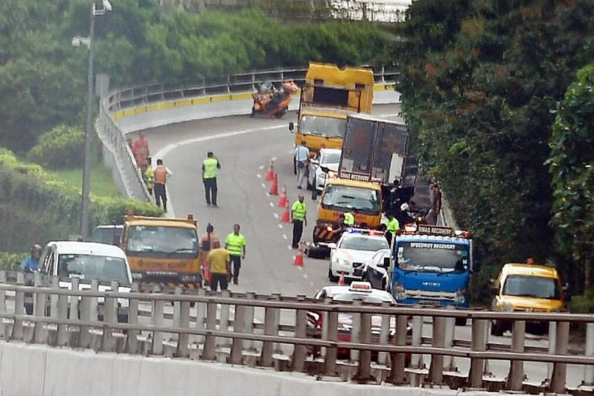 Yesterday's accidents took place at around 7.20am along the SLE, after Woodlands Avenue 2. They happened in the area connecting to a slip road towards Bukit Timah Expressway, in the direction of the Pan-Island Expressway.