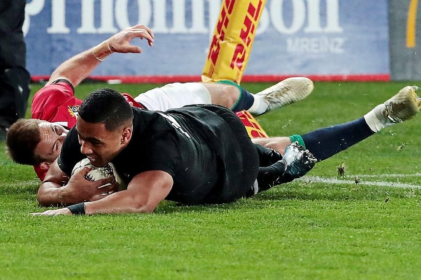 New Zealand's Ngani Laumape scores a first-half try as the Lions' Liam Williams attempts to tackle him. The All Blacks led 15-12 before the Lions equalised in the 78th minute.