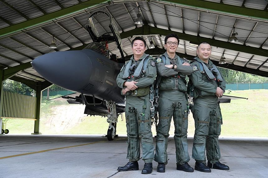 Senior Lieutenant-Colonel Goh Sim Aik (centre), mission lead of the NDP 2017 aerial salute, with the two operationally ready national servicemen pilots - Captain (NS) Valent Tan (left) and Major (NS) Timothy Siah.