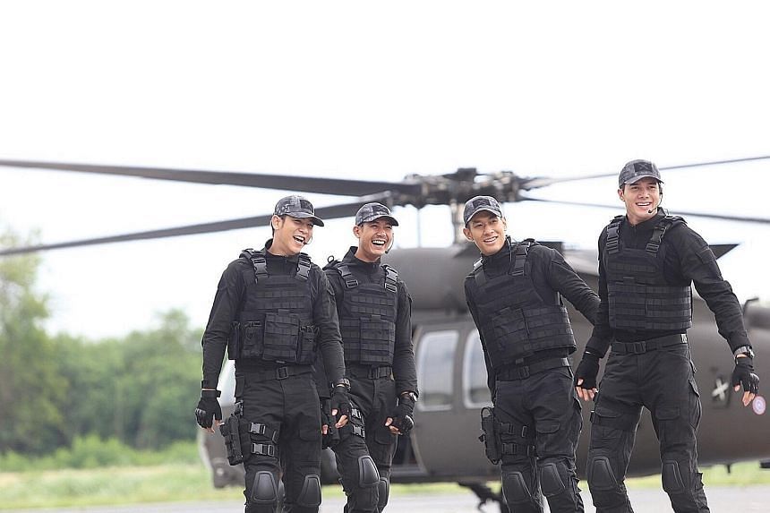 Cast members on the set of Thai drama Love Missions. The series follows four leading men as they pursue drug traffickers, terrorists - and love interests. The name of the first instalment, Pull The Trigger On My Heart, became a trending hashtag on Tw