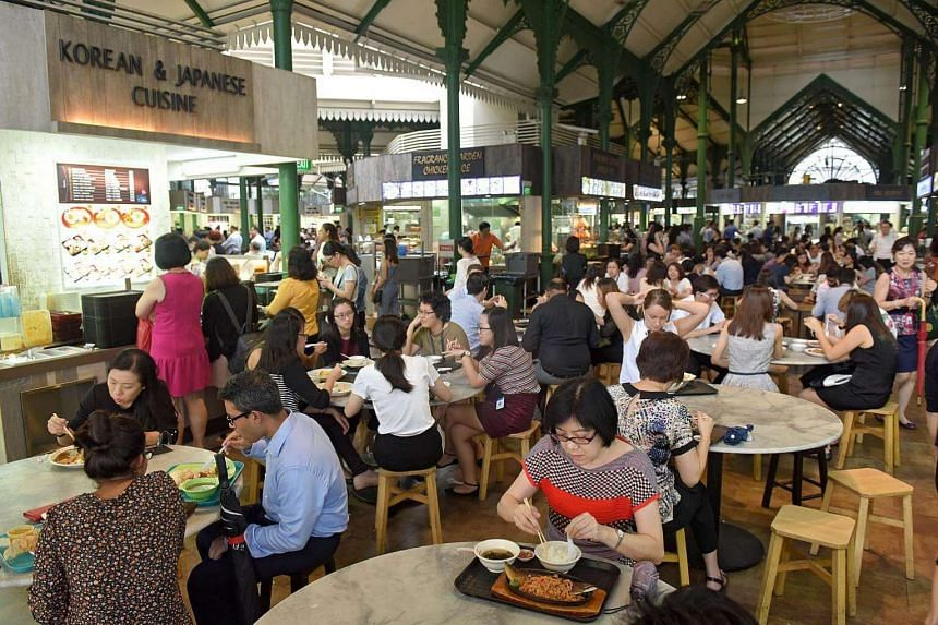 Diners during office lunch hour at Lau Pa Sat hawker centre.