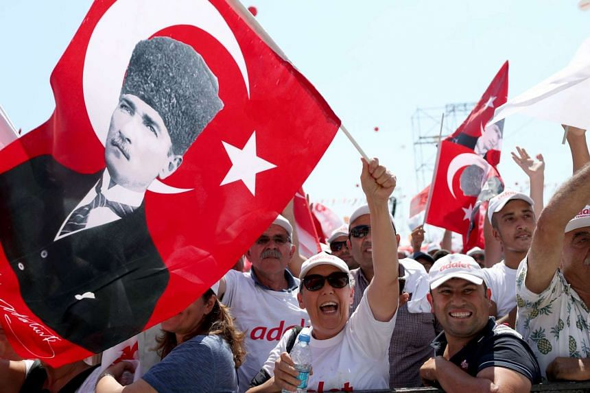 Supporters of Turkey's main opposition Republican People's Party (CHP) shouting slogans and waving Turkish flags with portraits of Kemal Ataturk in Istanbul, on July 9, 2017.
