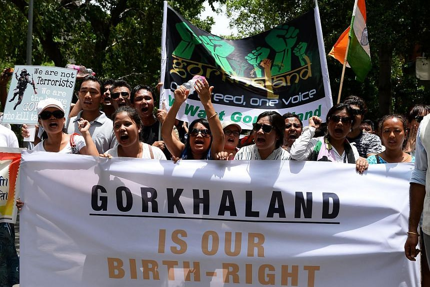 Supporters of the Gorkha Janmukti Morcha shouting slogans at a protest rally in New Delhi on July 9, 2017.
