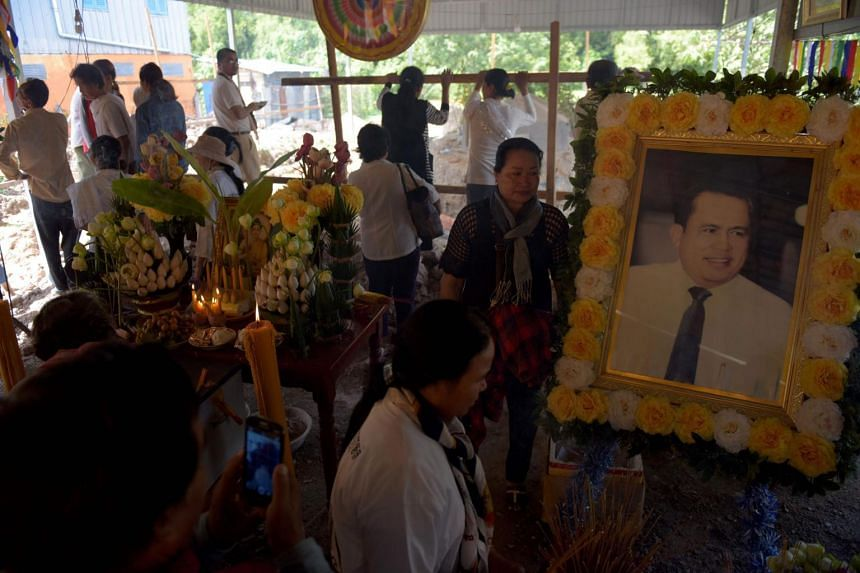 People visiting the grave of Cambodian critic Kem Ley on July 9, 2017.