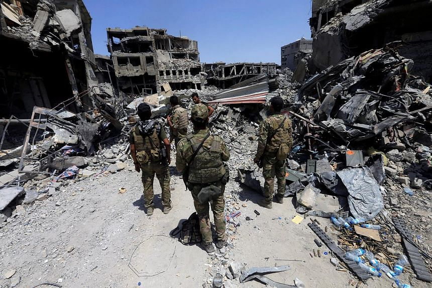 Members of Iraq's Emergency Response Division walking through the Old City of Mosul on July 9, 2017.