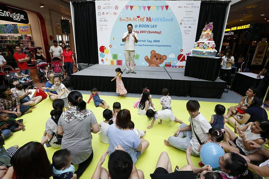 Boon Lay grassroots adviser Patrick Tay speaking to parents at the launch of the Embracing Parenthood Celebrations programme in Boon Lay on July 9, 2017.