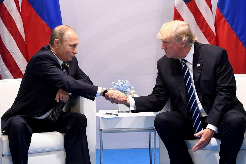 US President Donald Trump and Russian President Vladimir Putin speaking during a meeting on the sidelines of the G-20 Summit in Hamburg, on July 7, 2017.