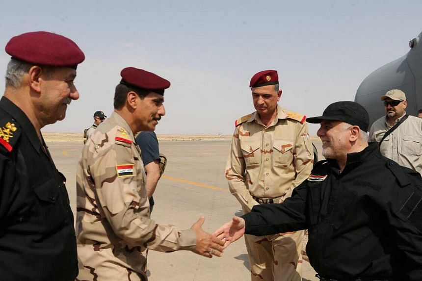Iraqi Prime Minister Haider al-Abadi (right) is pictured in Mosul on July 9, 2017.