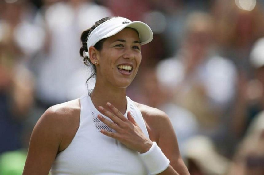 Spain's Garbine Muguruza celebrates beating Germany's Angelique Kerber during their women's singles fourth round match on the seventh day of the 2017 Wimbledon Championships, on July 10, 2017.