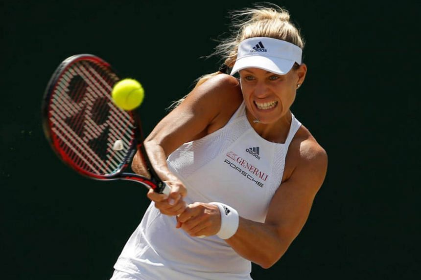 Germany's Angelique Kerber in action during her fourth round match against Spain's Garbine Muguruza at The All England Lawn Tennis Club in Wimbledon, on July 10, 2017.