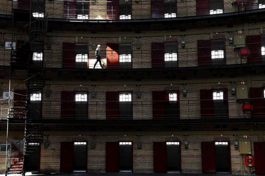 A woman walks through Boschpoort Prison, a dome-shaped prison in Breda, which is being transformed into offices and an entertainment venue following a drop in incarcerations in Dutch prisons for the past 20 years on June 9, 2017 in Breda.