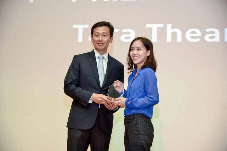 Ms Tara Thean, 26, receiving first prize of the Asian Scientist Writing Prize 2017 at Science Centre Singapore from Minister for Education (Higher Education and Skills), Mr Ong Ye Kung, on July 7.