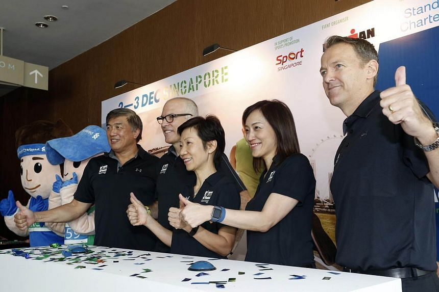 At the launch of this year's Standard Chartered Marathon Singapore are (from left) Mr Lim Teck Yin, Mr Andrew Messick, Ms Grace Fu, Ms Judy Hsu and Mr Geoff Meyer.