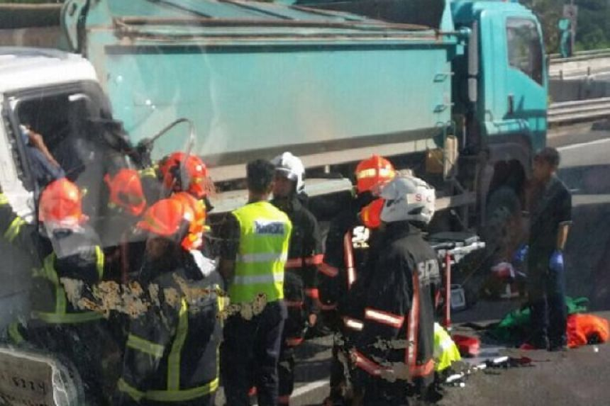 A man was reportedly trapped in his seat after his vehicle hit another along the Seletar Expressway.