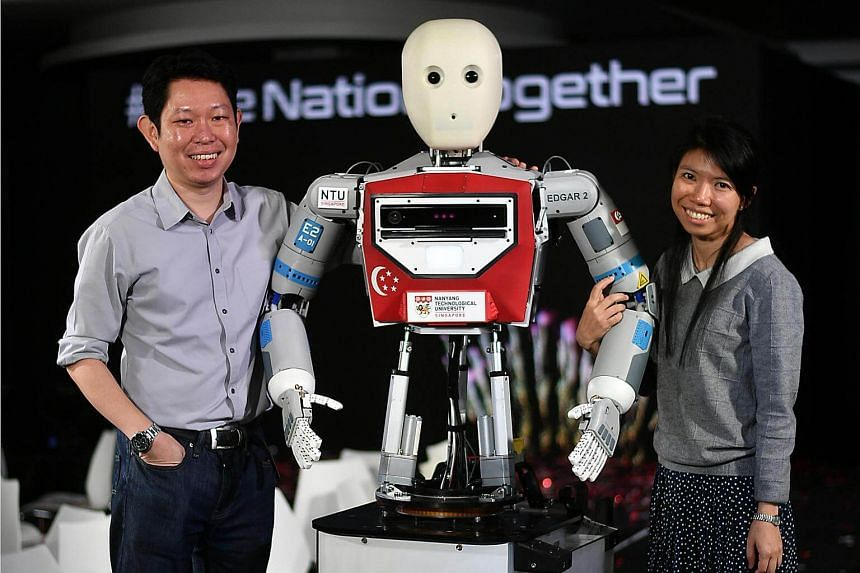 (From left) Dr Wong Choon Yue, Research Fellow, at NTU School of Mechanical and Aerospace Engineering and Ms Pang Wee Ching, a Research Associate with their robot Edgar who will be hosting the NDP show.