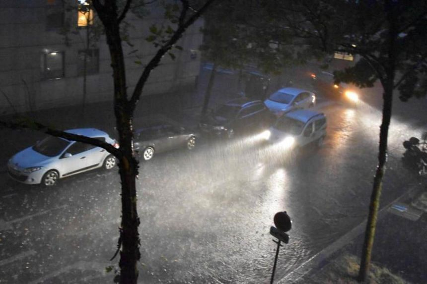 Paris subway authorities closed metro stations due to flooding after thunderstorms and heavy rain pounded the French capital on July 10, 2017.
