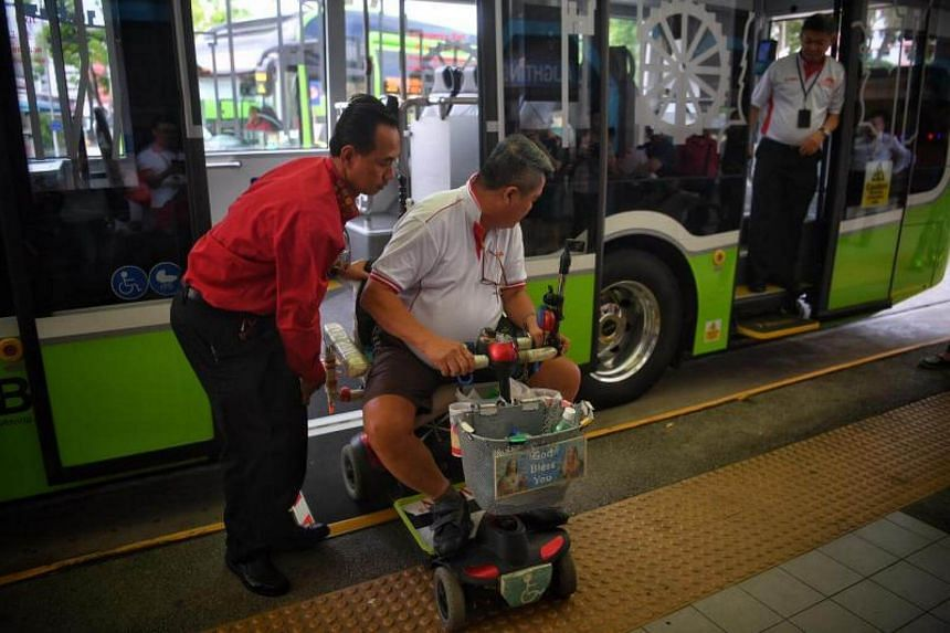 A member of the Handicaps Welfare Association tries out the wheelchair ramp on the new three door single-deck 190 at Choa Chu Kang Bus Interchange on June 19, 2017.
