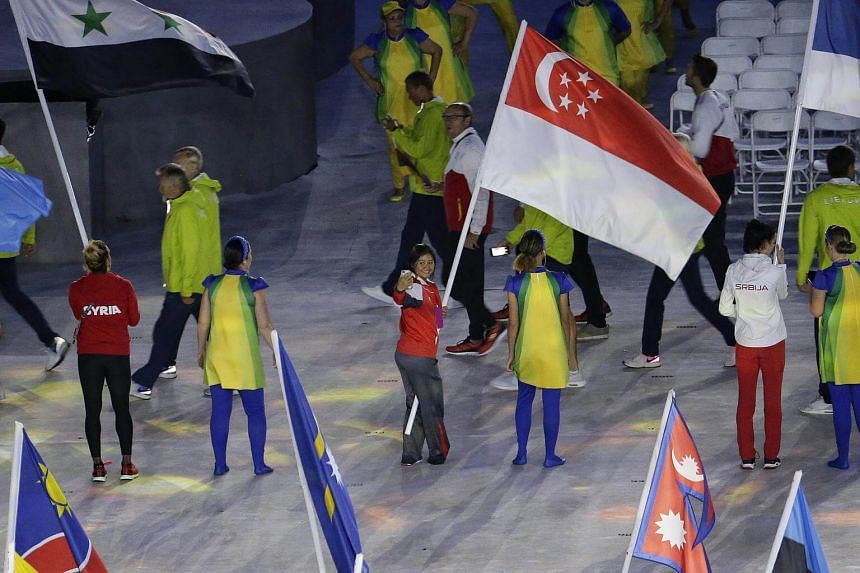 Singapore's flag bearer Griselda Khng taking a selfie during the closing ceremony of the Rio 2016 Olympic Games at the Maracana in Rio de Janeiro, Brazil, on Aug 21, 2016.