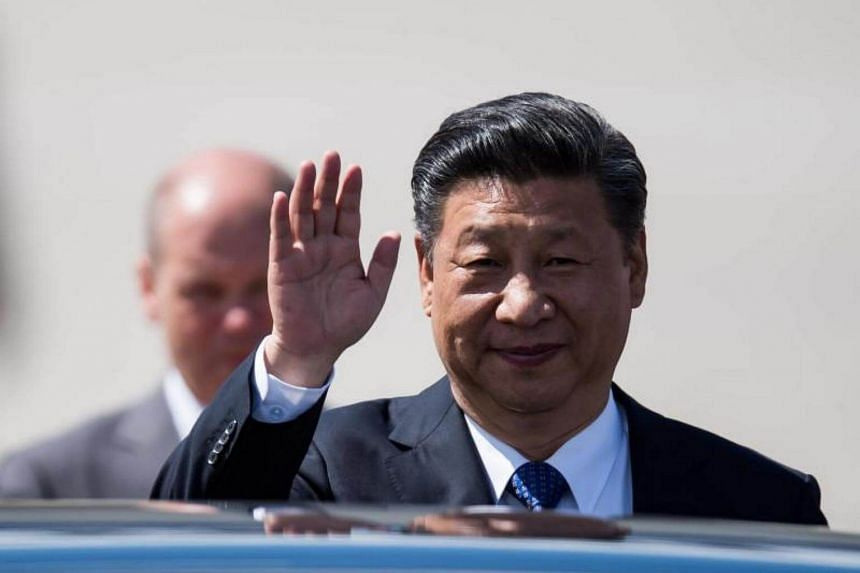 President of China, Xi Jinping waves as he arrives at Hamburg Airport ahead of the G20 summit in Hamburg, Germany, on July 6, 2017.