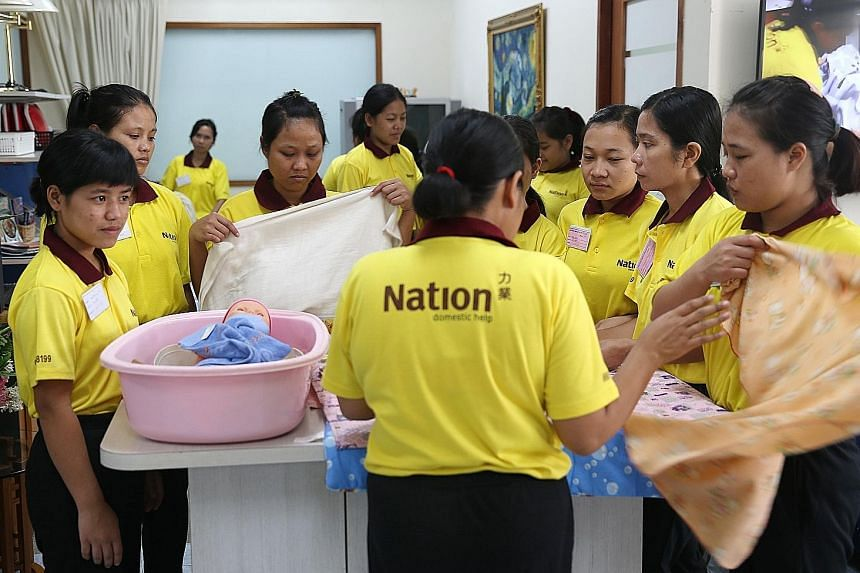 A training session for foreign domestic workers (FDWs) at maid agency Nation Employment, which works with the police to conduct briefings every two months for workers. Since January, there have been two more cases of radicalised FDWs in Singapore, br