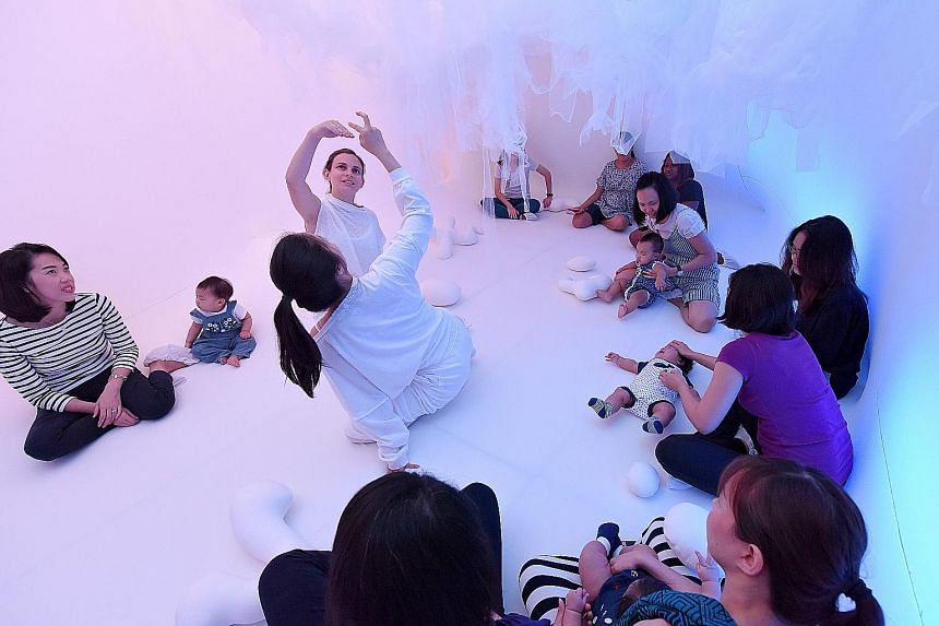 Ms Wang Tingting and her nine-month-old daughter Sophie Wiranata explore Baby Space (above), an installation designed for babies aged 16 months and below.