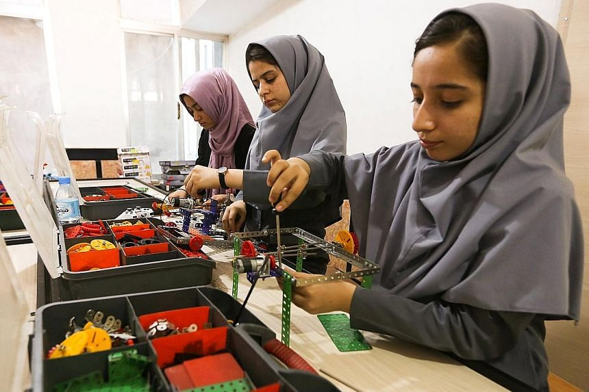 Members of the Afghan robotics team who were denied visas to take part in an robotics contest in Washington. The girls said US consular officers had asked whether they had relatives in the US and whether they intended to return home after the competi