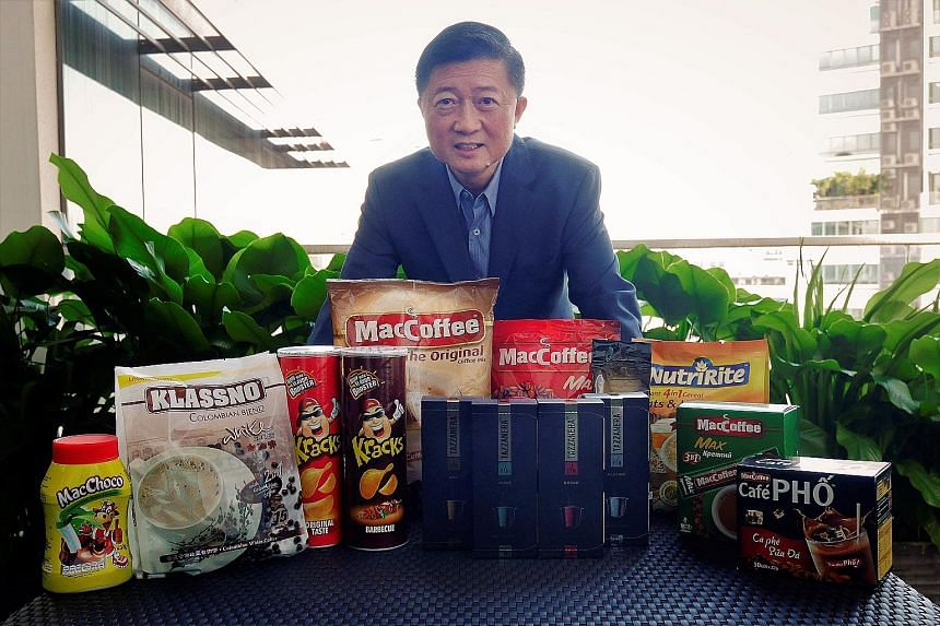 Mr Tan Wang Cheow with some of Food Empire's products. The company holds a 50 per cent share in the Russian instant coffee mix segment, and the country is its largest market, accounting for nearly half of total revenues last year.