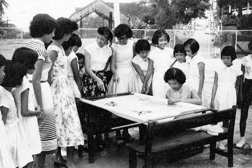 Students, staff, parents, alumni and the board of directors of Nan Hua Primary School creating a mass display in celebration of the school's centenary this year. 1950s: Teachers conducting outdoor sewing lessons at the then Nan Hwa Girls' School. 196