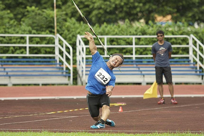 Javelin thrower and shot putter Muhammad Diroy Noordin competing yesterday at the National Inclusive Athletics Championships at Toa Payoh Stadium. About 160 participants attended the 45th edition of the event, where Senior Minister of State, Ministry