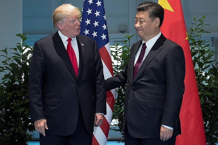 US President Donald Trump meeting Chinese President Xi Jinping on the sidelines of the G-20 summit in Hamburg, Germany, last Saturday.
