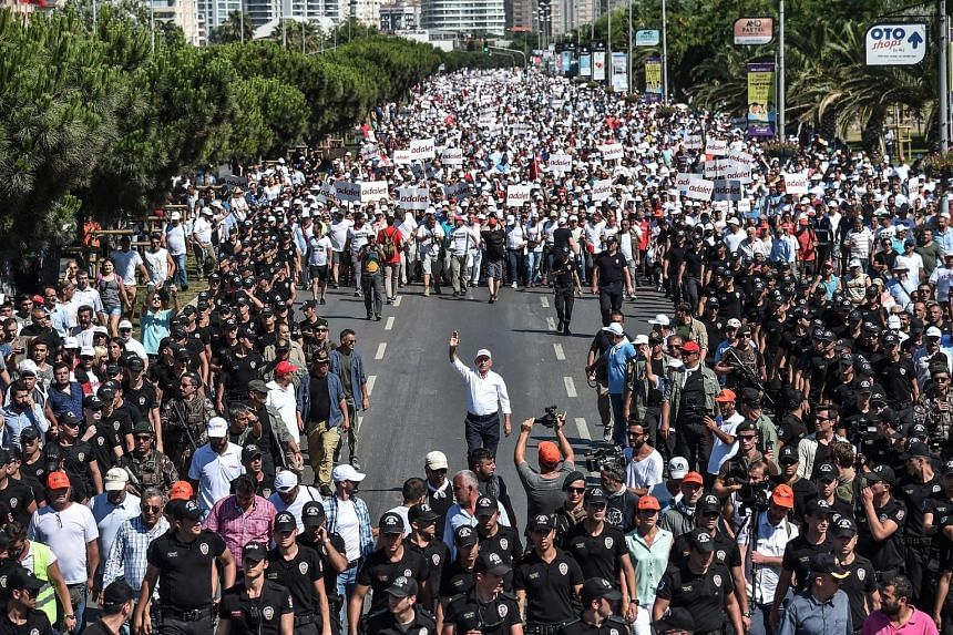 Supporters of Republican People's Party leader Kemal Kilicdaroglu (centre) walk alongside him on the 24th day of the march for justice in Istanbul on Saturday.