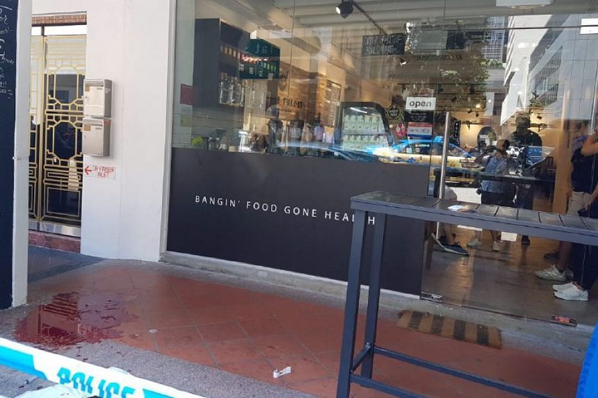 A pool of blood is seen outside a restaurant along Boon Tat Street, after a stabbing incident there on July 10, 2017.
