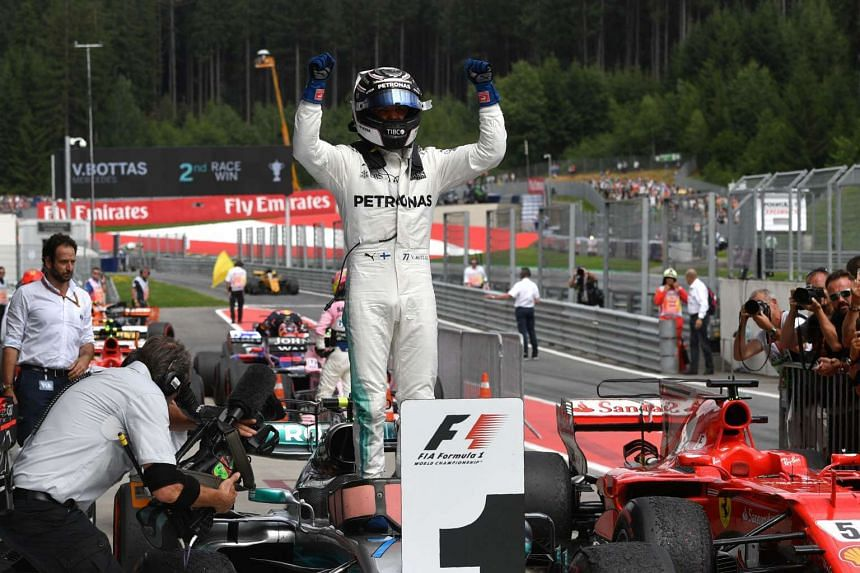 Mercedes' Finnish driver Valtteri Bottas celebrates after winning the Formula One Austria Grand Prix at the Red Bull Ring in Spielberg, on July 9, 2017.