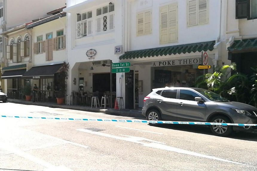 A police cordon is seen along Boon Tat Street, after a stabbing incident on July 10, 2017.