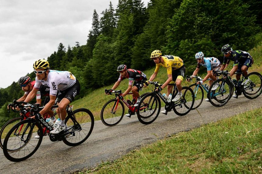 Great Britain's Christopher Froome (4th from left), wearing the overall leader's yellow jersey, ride during the 181,5 km ninth stage of the 104th edition of the Tour de France cycling race on July 9, 2017 between Nantua and Chambery.