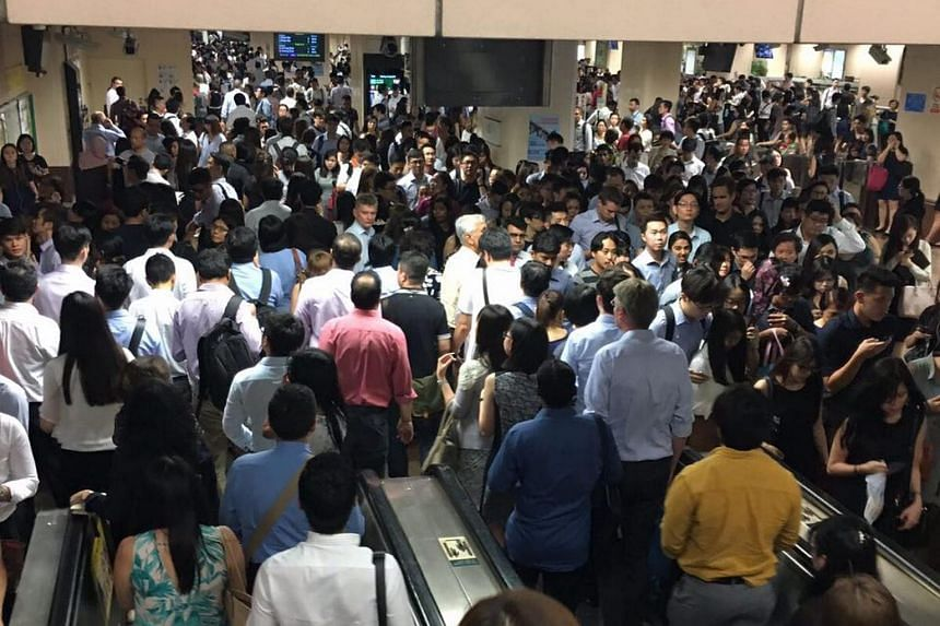 The crowd at Raffles Place station, after a signalling fault delayed services on the East-West Line, on July 10, 2017.