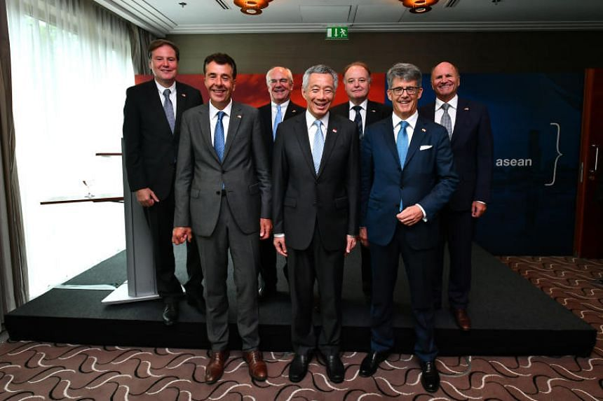 (From left) Dr Heinz-Juergen Bertram, Dr Roland Gerner, Dr Michael Schadlich, Prime Minister Lee Hsien Loong, Dr Gunther Kegel, Mr Thomas Fischer, and Mr Hans-Peter Metzler at The Charles Hotel, on July 10, 2017.