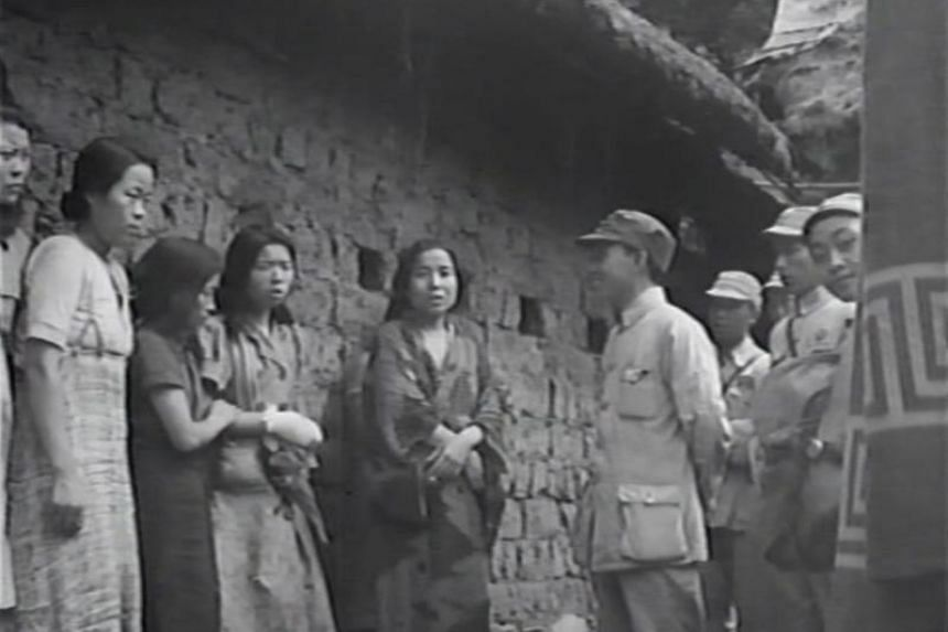 An undated handout made available on 10 July 2017 by the Seoul Metropolitan Government and the Seoul National University Human Right Center shows a video grab of what is believed to be the first footage of 'comfort women' lining up in front of soldi