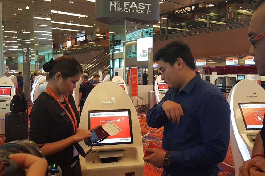 Jetstar Asia has deployed roving check-in agents (left) with iPads and portable printers, to help ease queues.