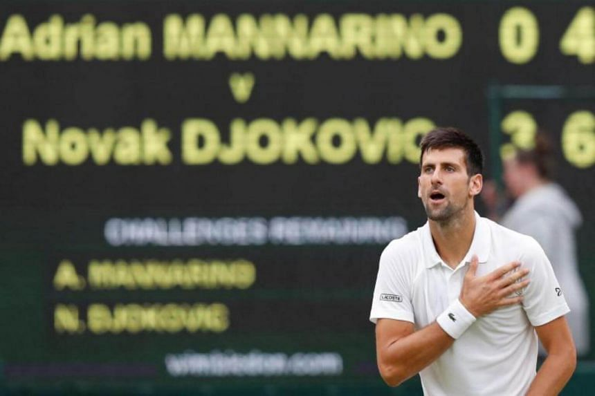 Serbia's Novak Djokovic gestures to the crowd after beating France's Adrian Mannarino during their men's singles fourth round match on the eighth day of the 2017 Wimbledon Championships in Wimbledon, on July 11, 2017.