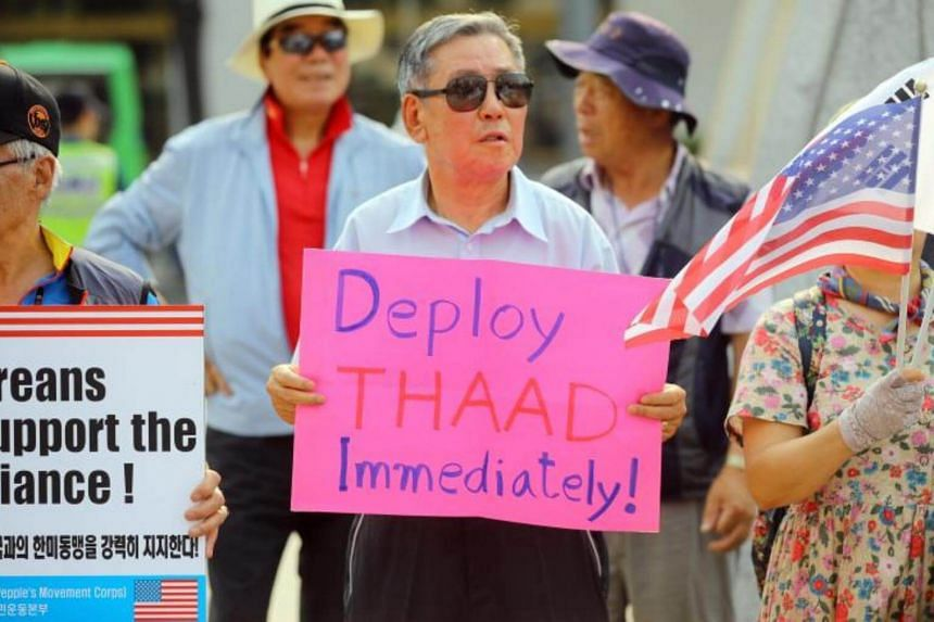 A group of supporters of the deployment of the US Terminal High Altitude Area Defense (THAAD) anti-missile system hold a rally to demand the immediate deployment of the THAAD battery in South Korea, on June 29, 2017.