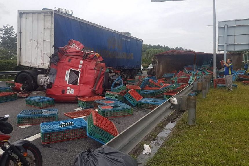 Two trailer trucks collided on the Malaysian side of Tuas Second Link, injuring three people.