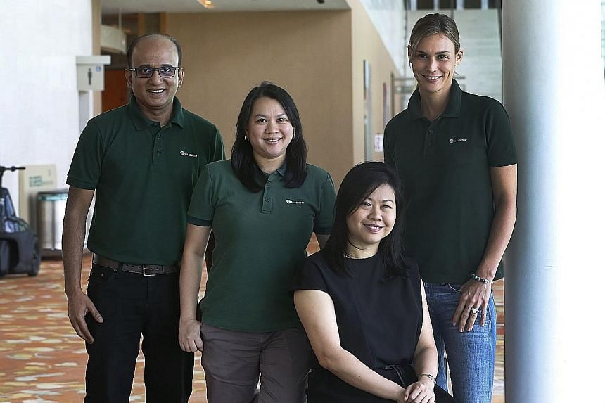 SaladStop! director Katherine Braha Desbaillets (right) with Ark Solutions director Kris Loy (seated), who mentored the salad store chain's district managers Daniel Arumugam and Sherill E. Dela Cruz.