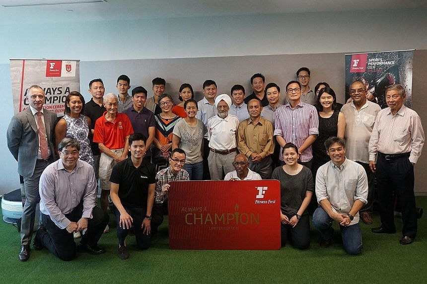 """Team Singapore Olympians past and present gather for the announcement of """"Always a Champion"""", held at Fitness First's premises at Capital Tower Sports Performance. The recipients were given free memberships to use until the 2020 Tokyo Olympics."""