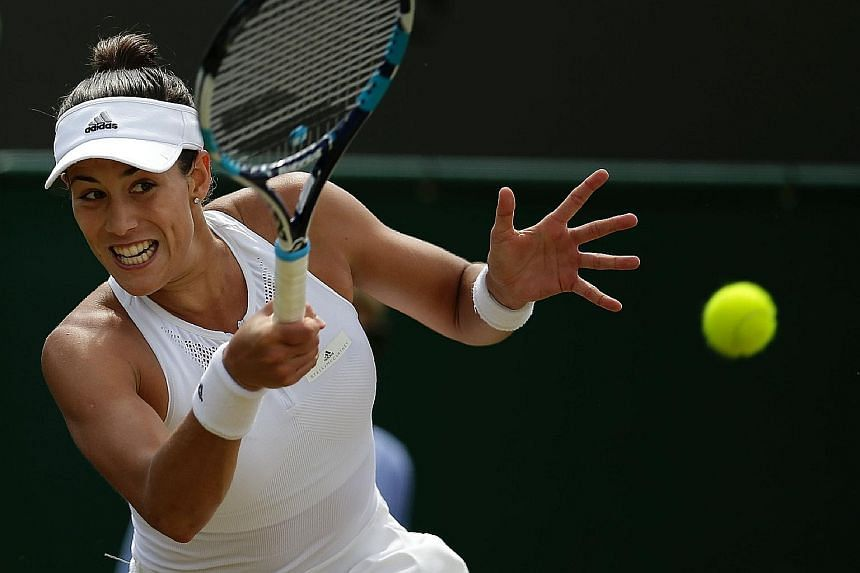 Garbine Muguruza hits a return against Angelique Kerber. The Spanish world No. 15 prevailed in three sets to reach the last eight where Venus Williams, the oldest Wimbledon quarter-finalist since 1994, awaits.