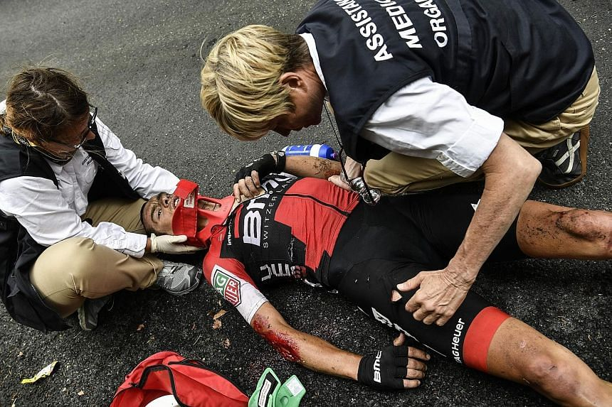 Richie Porte receives medical assistance after falling during the ninth stage of the Tour. The Australian broke his collarbone and pelvis descending Mont du Chat.
