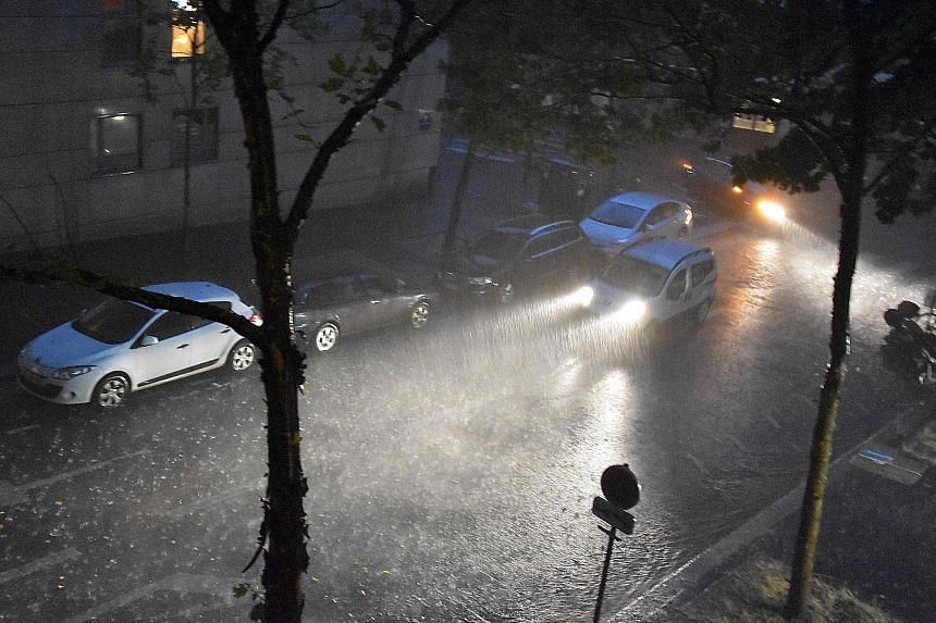 A monsoon-like rainstorm has dumped a record amount of rain on Paris, flooding streets, snarling traffic and briefly forcing the closure of metro stations. Sunday's downpour forced about 15 underground railway stations to close due to flooding, three