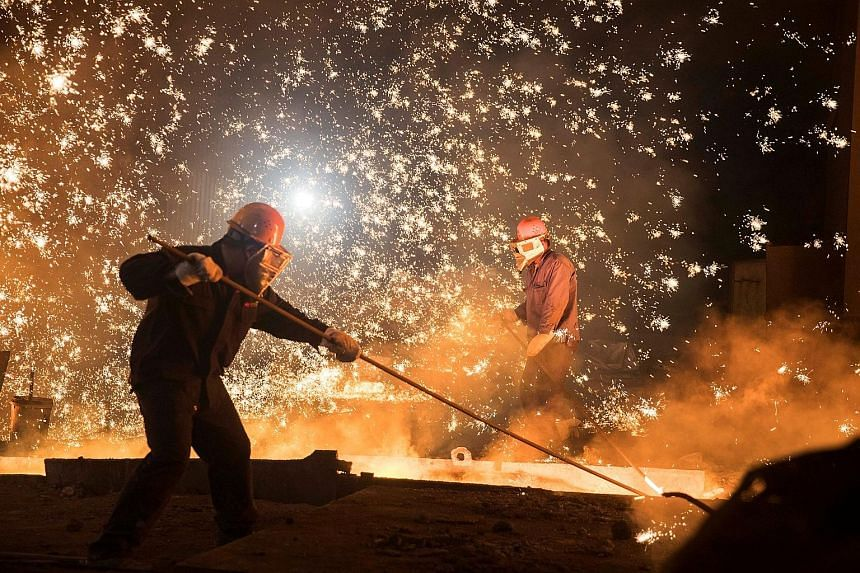 Workers at Shandong Iron and Steel Group's plant in Jinan, Shandong province. Even as inflation steadies on weaker commodity prices, regulatory curbs on excessive borrowing may erode momentum later this year.