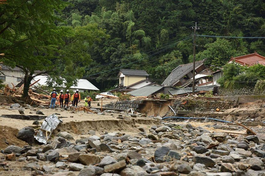 A rescue team arrives at a disaster area following heavy flooding in Asakura, Fukuoka prefecture, on July 7, 2017.